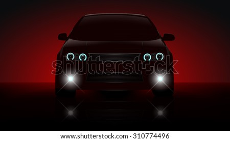 red car with parking lights on