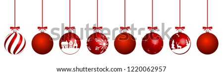 Red christmas balls with different patterns on white.
