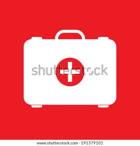Red first aid box on red background