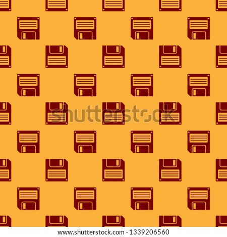 Red Floppy disk for computer data storage icon isolated seamless pattern on brown background. Diskette sign. Flat design. Vector Illustration