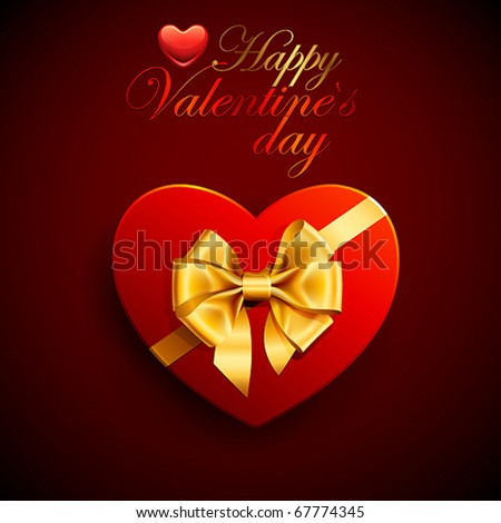 Red heart shape gift with golden bow