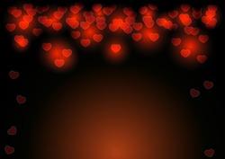 Red heart shape glowing on dark background.