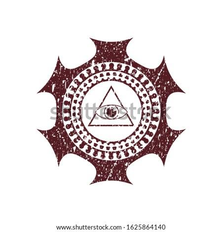 Red illuminati pyramid icon inside rubber stamp