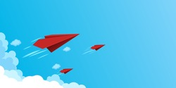 Red paper airplanes flying on blue sky.Business teamwork and leadership concept.