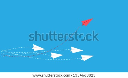 Red plane changes direction. New idea, change, trend, courage, creative decision, innovation and unique concept of the path.