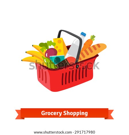 Red plastic shopping basket full of groceries. Supermarket or local store.