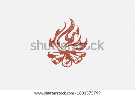 Red silhouette of hot campfire burning on logs on campsite hand drawn stamp effect vector illustration. Vintage grunge texture on old paper for poster or label decoration.