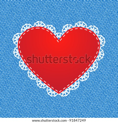 Red silk heart with lace on denim background