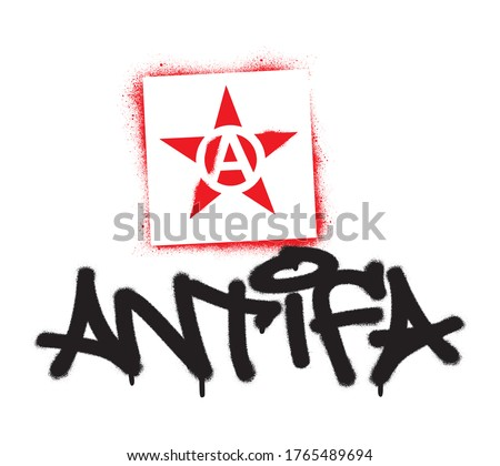 Red star stencil and ANTIFA tag spray paint graffiti. Common name for militant and radical antifascists, communists, leftists and anarchists. Photo stock ©