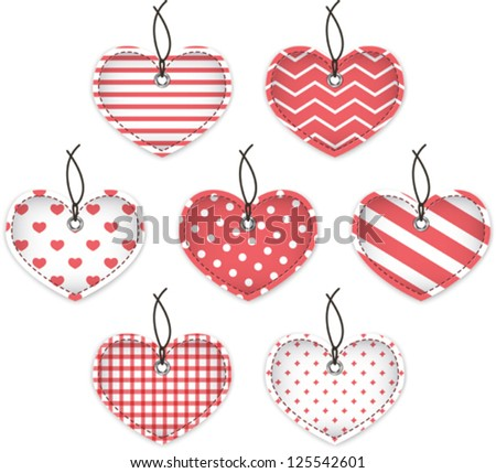 Red textured hearts for Valentine's Day. Hanging labels. Vector illustration