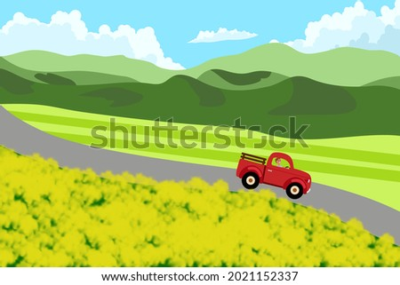 red truck on the road of yellow