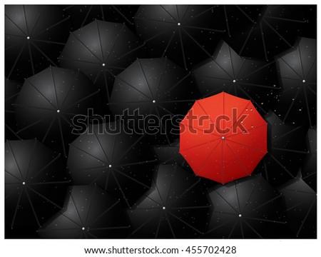 red umbrella over mass of black