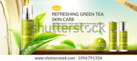 Refreshing green tea skin care products with leaves and liquid pouring down from top on bokeh outdoor background.