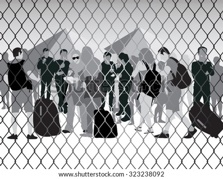 refugees behind metal bars and