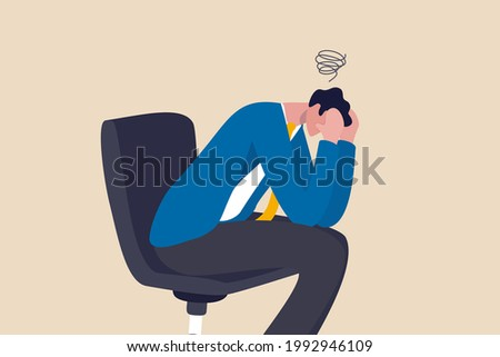 Regret on business mistake, frustration or depressed, stupidity or foolish losing all money, stressed and anxiety on failure concept, frustrated businessman holding his head sitting alone on the chair Stock foto ©