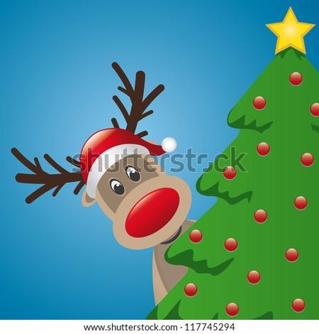 reindeer with santa hat behind christmas tree