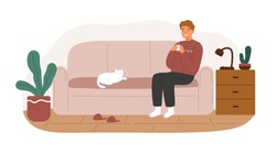 Relaxed man in warm sweater sitting on couch with hot beverage vector flat illustration. Smiling male spending time at living room coziness interior isolated. Happy guy resting on sofa with cat