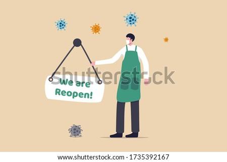 Reopen business to normal operation after COVID-19 Coronavirus lockdown concept, shop owner wearing face mask hanging sign written the word Reopen at store front with virus pathogen.