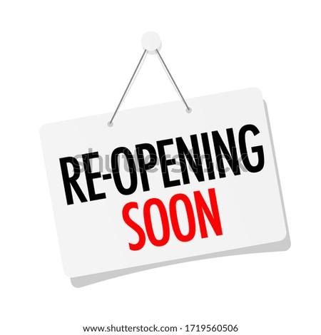 Reopening soon on door sign