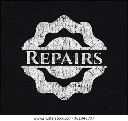 Repairs chalk emblem written on a blackboard