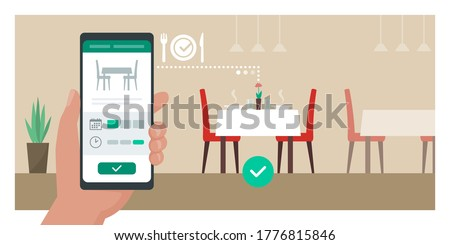Restaurant virtual reservation: user booking a table at the restaurant using a mobile app on his smartphone