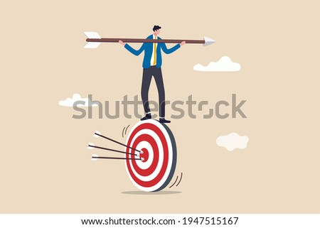 Result oriented business strategy or result driven, professionally set up and achieve business target concept, smart businessman balance and control rotating archery target with arrow hitting bullseye 商業照片 ©