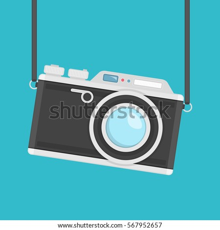 Retro camera in flat style on a colored background. Old camera with strap. Flat design vector illustration. Vintage Camera image. EPS 10.