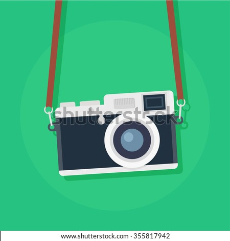 Shutterstock Retro camera or vintage camera in a flat style on a colored background. Old camera with strap. Isolated antique camera. Hung retro camera.