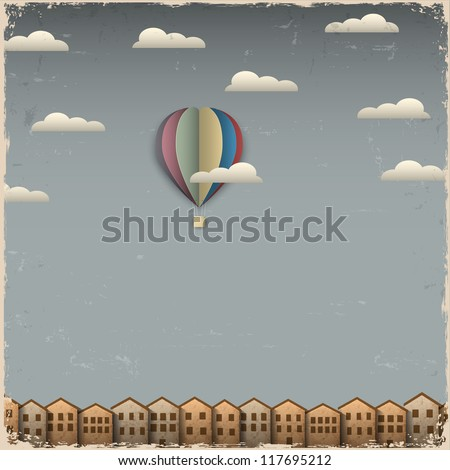 Retro hot air balloon and town from paper. Creative vector eps 10