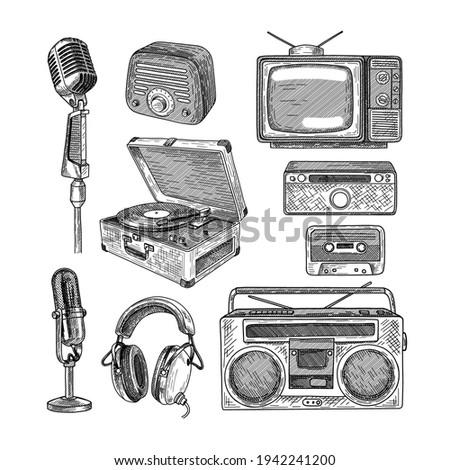 Retro media engraved illustrations set. Hand drawn sketch of vintage television, radio, tape recorder, cassette, microphones on white background. Nostalgia, retro technology, media, vintage concept Photo stock ©