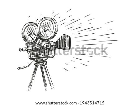 Retro movie camera in vintage engraving style. Screen version, screening sketch vector illustration Photo stock ©