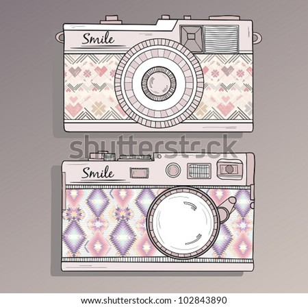 Retro photo cameras set. Vector illustration. Vintage cameras with ornaments. Camera with aztec style pattern.