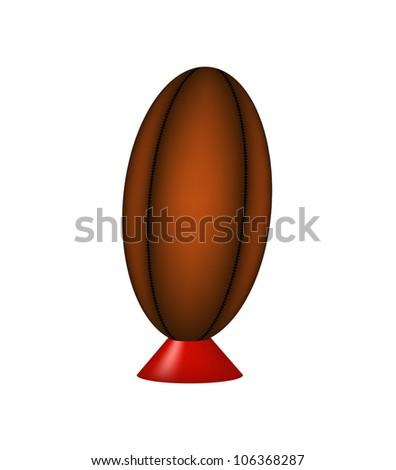 Retro rugby ball on kicking tee