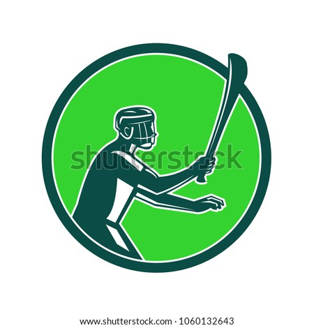 Retro style illustration of a hurling player holding a wooden stick called hurley viewed from side on isolated background.