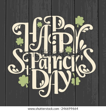 Retro style typographic design for Saint Patrick's Day on a gray wood background.