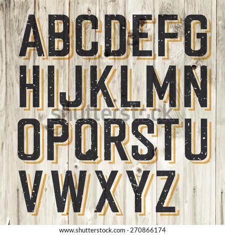 retro styled alphabet on wooden