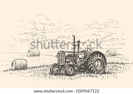 retro tractor in field hand...