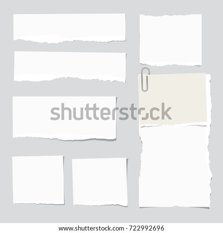Ripped white note strips, notebook, copybook paper sheet stuck on gray background.