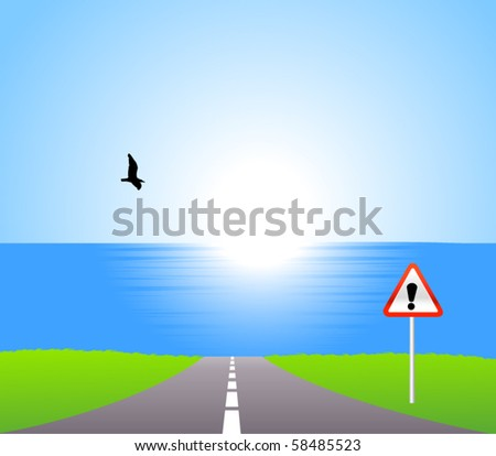 Road to sea with attention sign