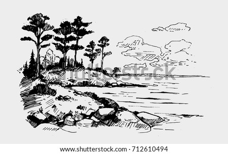rock with pines on the lake