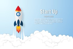 Rocket launch on the clouds and blue sky as paper art, craft style and business Startup project concept. flat design vector illustration.