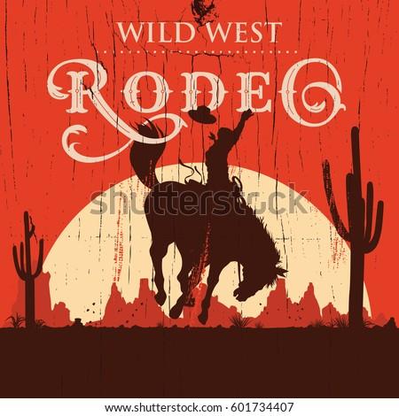 rodeo cowboy riding wild horse...