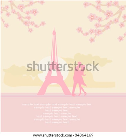 Romantic couple in Paris kissing near the Eiffel Tower.