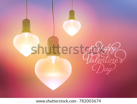 Romantic greeting template with inscription and realistic hanging glowing light bulbs in heart shapes on blurred background vector illustration stock photo