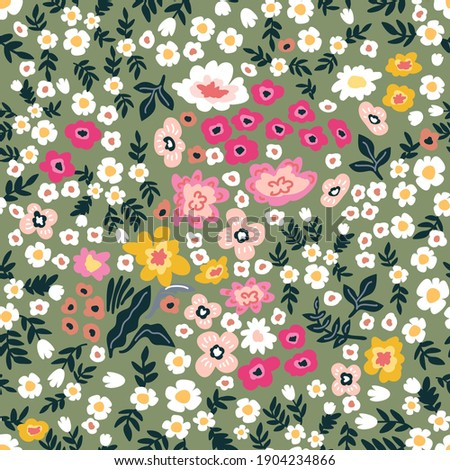 Romantic liberty print on green background. Seamless vector pattern in repeat. Vintage print with small inflorescences. Retro textile design collection.