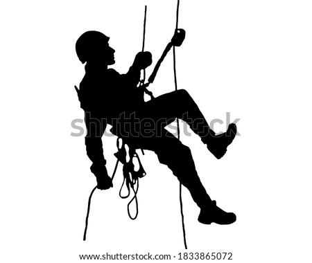 Rope access technician descending ropes