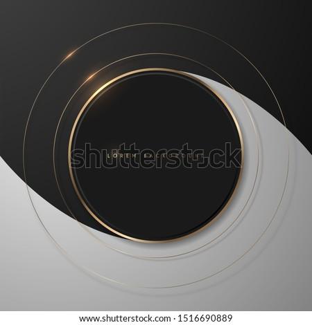 Round shiny gold frame on black and white background