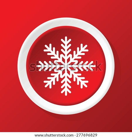 Round white icon with image of snowflake, on red background