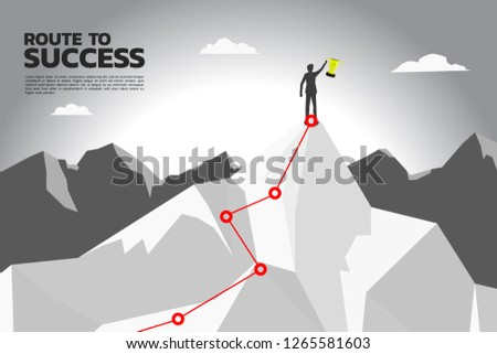 route to success. silhouette of businessman with champion trophy on the top of mountain. Concept of Goal, Mission, Vision, Success in Career path.