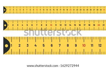 Ruler measuring long tape set. Yellow tape lines with inches and metric centimetres Foto stock ©